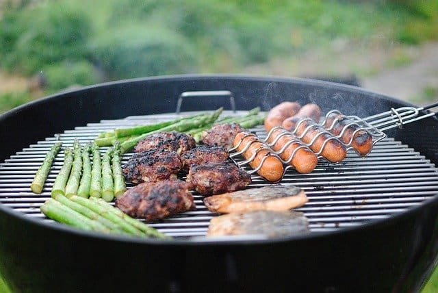 A pan of food on a grill